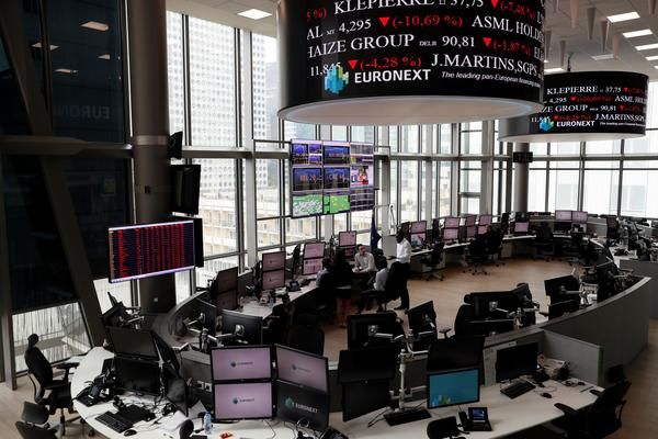 Screens show plunging stocks at the Euronext Stock Exchange services in Paris on Friday, as Britain votes to leave the European Union, fueling a wave of global uncertainty.