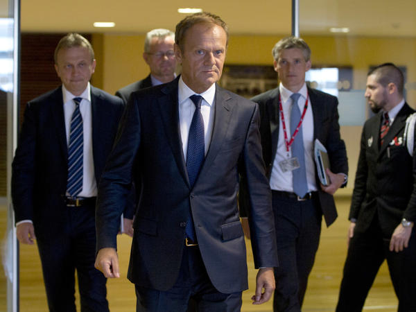 European Council President Donald Tusk (center) arrives for a meeting at EU headquarters in Brussels on Friday. Top European Union officials were hunkering down to ascertain next steps after British voters decided to leave the 28-nation bloc.