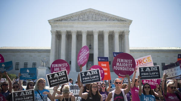 Abortion rights supporters and opponents rally outside of the U.S. Supreme Court on June 20.