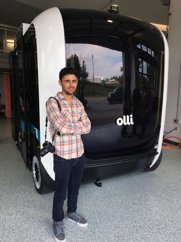 """Edgar Sarmiento <a href=""""https://cocreate.localmotors.com/eddie_mauro/berlino-30-smart-mini-bus-system/"""" target=""""_blank"""">won the Local Motors challenge</a> to design an urban public transportation system. His self-driving electric minibus design eventually became this vehicle called Olli."""