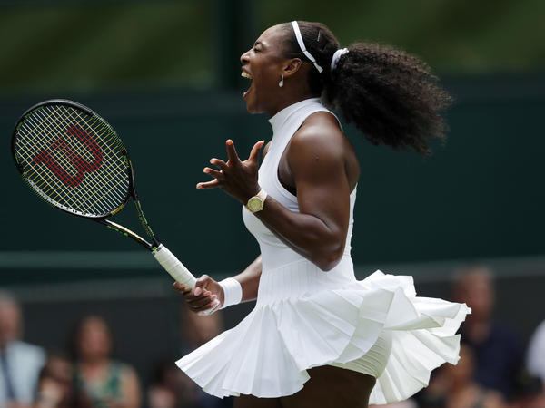 Serena Williams of the U.S celebrates a point during a match at Wimbledon. Her pleated Nike skirt was designed specifically for her.