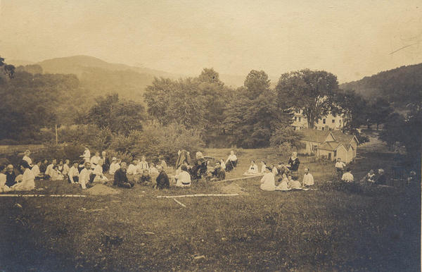 Community members enjoy a picnic on Gould Farm in Monterey, Mass., in the 1920s. Work on the farm remains a key part of the therapeutic process.