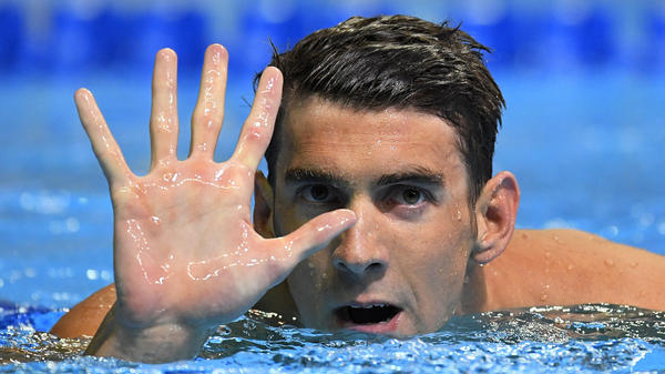 Michael Phelps celebrates qualifying for his fifth Olympic Games, after winning the men's 200-meter butterfly at the U.S. Olympic swimming trials Wednesday in Omaha, Neb.