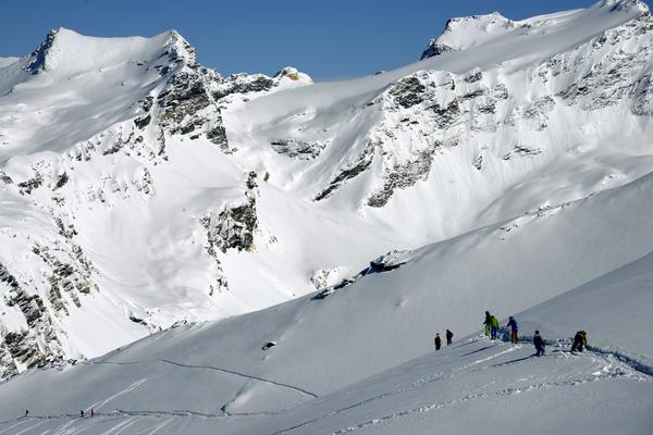 Skiers free-ride down a slope despite a high avalanche risk, at the ski resort in Val-d'Isere, in the French Alps, on March 2, 2014.