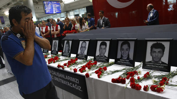 Family members and friends of the victims of the Istanbul attack paid tribute at a memorial service Thursday at Ataturk Airport. Turkish authorities say the evidence points to three Russian-speaking suicide bombers who were part of the Islamic State.