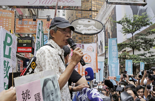 Freed Hong Kong bookseller Lam Wing-kee speaks in front of his Hong Kong bookstore on June 18. He spent months in detention on the mainland for publishing banned books critical of China's Communist leadership.