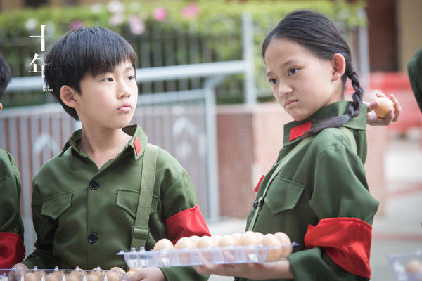 One of the stories in <em>Ten Years</em> is about a Hong Kong grocer whose son is part of the Youth Guards at school. The commanders order the boy and his classmates to report people selling products labeled as local, including eggs at his father's shop.