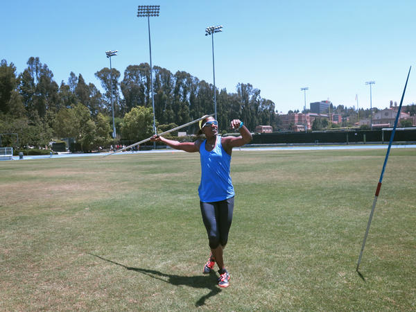 "Sharon Day-Monroe practices the javelin, one of the seven events that make up the heptathlon, at UCLA's Drake Stadium, in Los Angles, in June. ""No matter what the workout is, I always get a sick feeling in the pit of my stomach,"" Day-Monroe says."