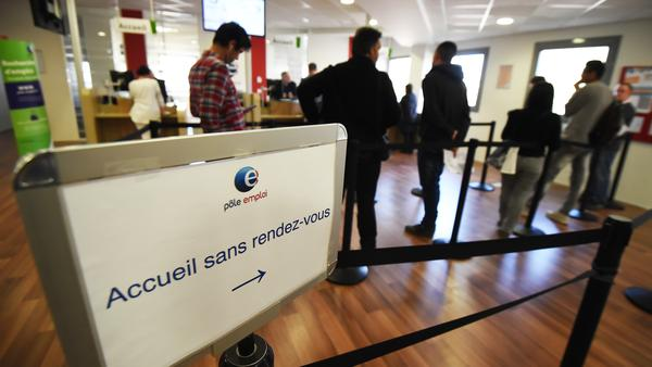 "People wait in a branch of France's national employment agency Pole Emploi, where a board read ""reception without appointment"" April 27 in Montpellier, southern France. While the economy is healthier in France than other European countries, unemployment remains above 10 percent."