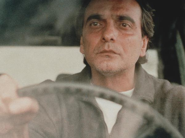 Kiarostami's <em>Taste of Cherry</em> won the Palme d'Or at the 1997 Cannes Film Festival. It follows a man (Homayoun Ershadi) who is contemplating suicide and drives around Tehran looking for someone to bury him.