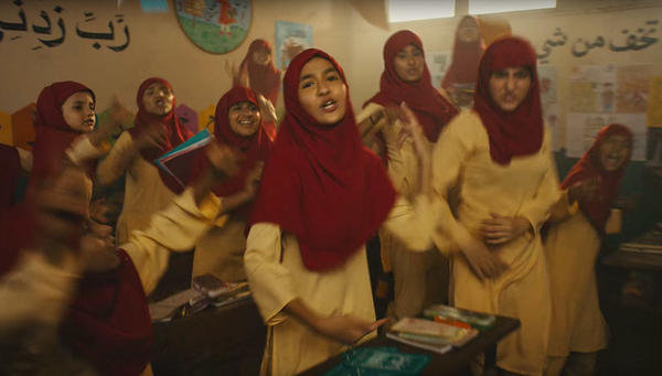 One scene from the video is set in a school, with the girl students wearing hijabs.