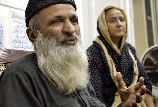 Abdul Sattar Edhi talks about his charity work in a 2004 interview, as his wife Bilquis Edhi looks on. His offices were located amid a labyrinth of shabby rooms in Karachi's old quarter. His private welfare network provided many services nationwide, helping the poor, the disabled and victims of violence.