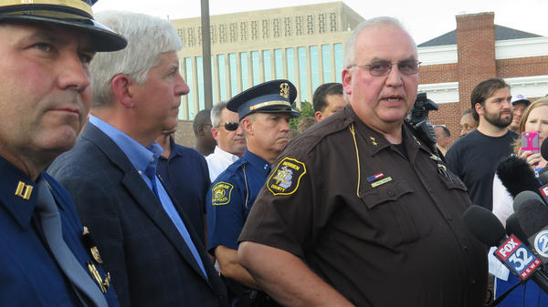 Berrien County, Mich., Sheriff Paul Bailey says a prisoner disarmed an officer, shot and killed two bailiffs and wounded a deputy sheriff Monday at the county courthouse before officers killed the gunman.