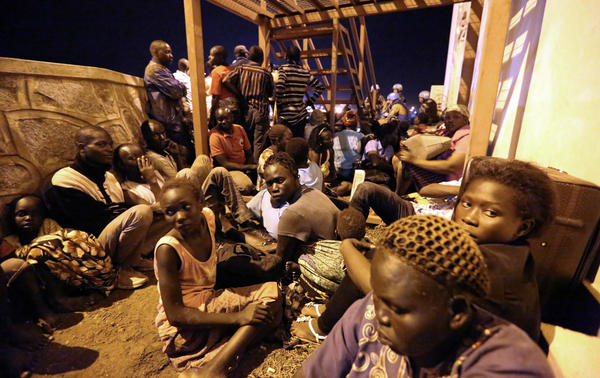 South Sudanese huddled for safety as fighting erupted in Juba on July 8.