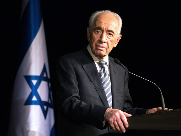 President Shimon Peres addresses members of the Foreign Press Association during a visit to the southern Israeli town of Sderot in July 2014, following Palestinian rocket attacks on the city.