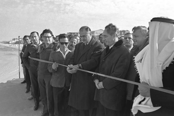As transportation minister, Peres (third from right), with Southern Command Gen. Ariel Sharon at his side, watches as Mayor Rushad A'Shava cuts the ribbon on Jan. 13, 1972, to open the new pier at the Palestinian port in Gaza City in the Gaza Strip, some 4 1/2 years after the 1967 Six-Day War.