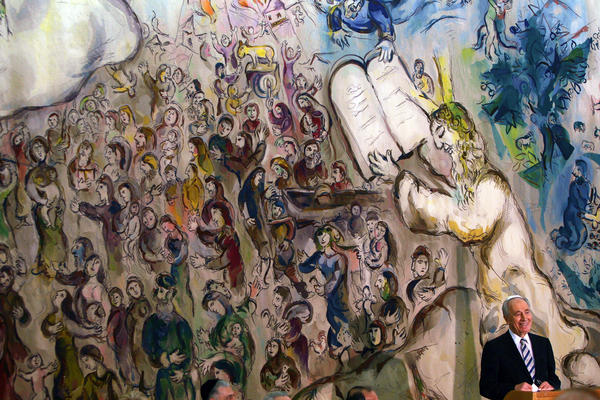 Peres speaks to Israeli lawmakers in Jerusalem on Jun. 13, 2007, after his election victory to become Israel's ninth president. A large tapestry by artist Marc Chagall depicting biblical scenes, including Moses receiving the Ten Commandments, is behind him.