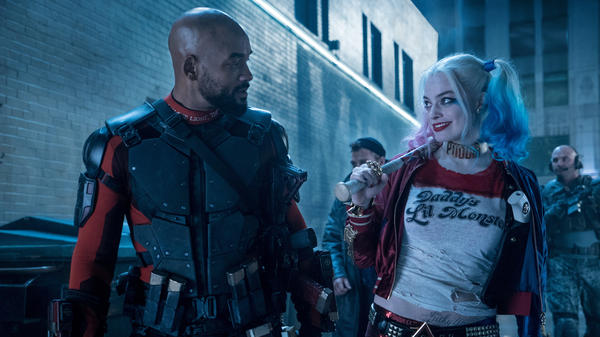 Will Smith plays Deadshot and Margot Robbie plays Harley Quinn in <em>Suicide Squad.</em>
