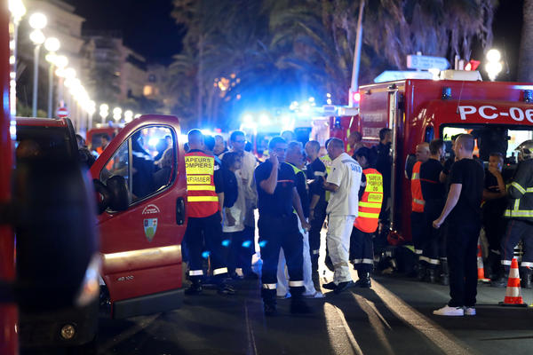 Police officers, firefighters and rescue workers at the Promenade des Anglais in Nice after a truck drove into a crowd watching a fireworks display in the French Riviera resort.