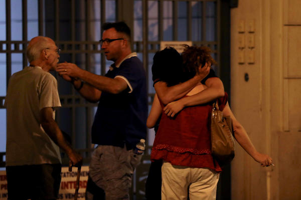 People in Nice react in the early hours of Friday morning after the attack.