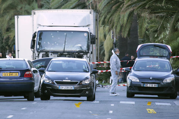 "Forensic police investigate a truck at the scene of an attack on the Promenade des Anglais in Nice. The BBC reports that the truck traveled more than a mile through the crowd, with eyewitnesses saying it ""swerved and zigzagged"" as it went."