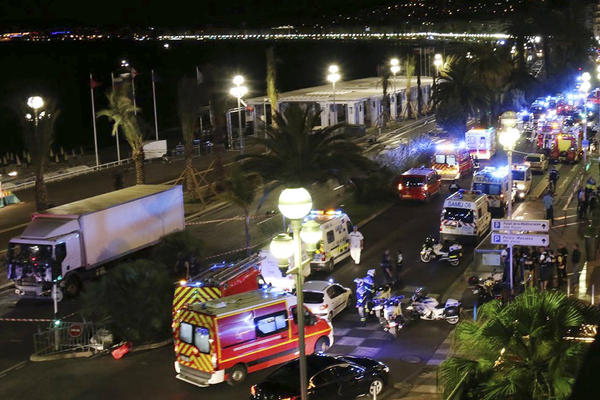 Emergency vehicles arrive after a truck plowed through Bastille Day revelers in the French resort city of Nice on Thursday.