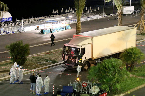 Authorities investigate a truck after it plowed through Bastille Day revelers in the French resort city of Nice on Thursday evening.