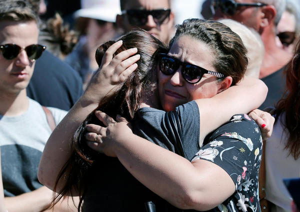 Women react near the scene of Thursday evening's attack in Nice.