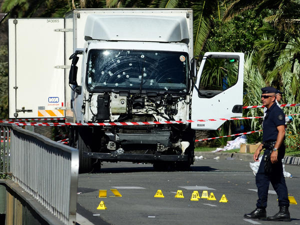 Forensic police investigate a truck at the scene of a terror attack on the Promenade des Anglais on Thursday evening in Nice, France. A French-Tunisian attacker killed 84 people as he drove a truck through crowds gathered to watch a fireworks display during Bastille Day celebrations.