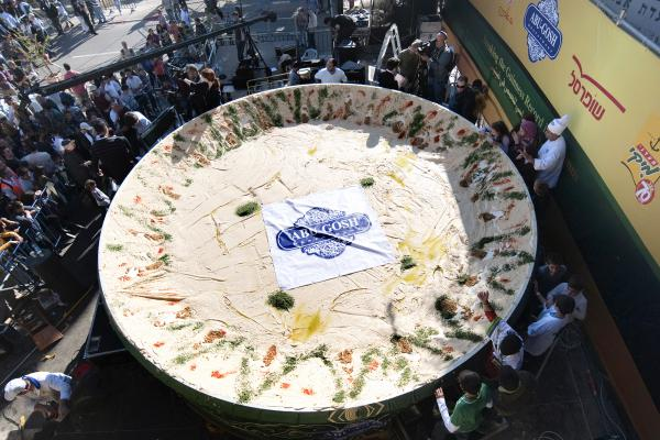 <strong>Counterattack:</strong> On Jan. 8, 2010, the Arab Israeli village of Abu Gosh served up this giant satellite dish full of hummus, weighing over 4 tons — about twice as much as the previous record set by Lebanon just months earlier.