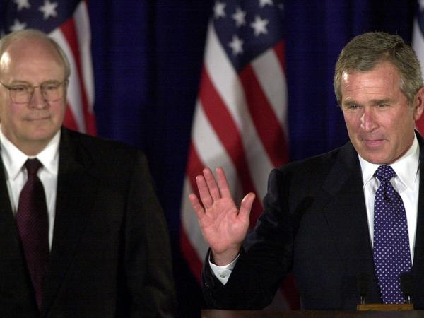 Republican presidential candidate Texas Gov. George W. Bush (right) introduces his vice presidential running mate, former Defense Secretary Dick Cheney, during a news conference on July 25, 2000, in Austin, Texas.