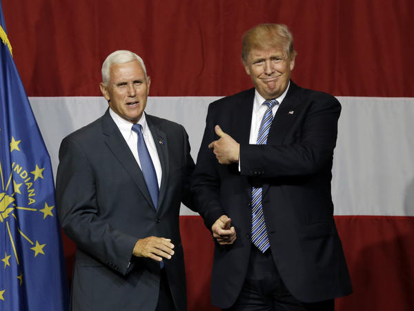 Indiana Gov. Mike Pence joins Republican presidential candidate Donald Trump at a rally in Westfield, Ind., on Tuesday.