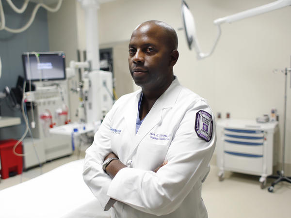 Dr. Brian Williams, a trauma surgeon at Parkland Memorial Hospital, poses for a photo at the hospital, Monday, July 11, 2016, in Dallas. Williams treated some of the Dallas police officers who were shot Thursday night in downtown Dallas. (AP Photo/Eric Gay)