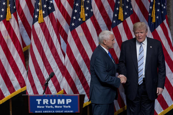 Donald Trump shakes hands with the man he picked to be his running mate, Gov. Mike Pence of Indiana, on Saturday in New York.