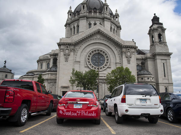 """A car with """"#Justice4Philando"""" written on it is parked outside the funeral of Philando Castile at the Cathedral of St. Paul."""