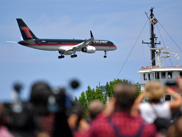 Donald Trump's plane arrives at a welcome event with Gov. Mike Pence at the Great Lakes Science Centre on Wednesday in Cleveland.