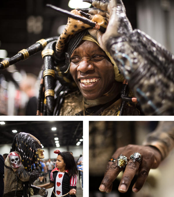 Jayson Brown of Sterling, Va., portrays Predator from the 1987 film. Brown has spent the past two years working on his costume, which includes a Predator ring that he wears even when he's not cosplaying. Brown's daughter Skyla Brown is dressed as the Queen of Hearts from <em>Alice in Wonderland</em>.