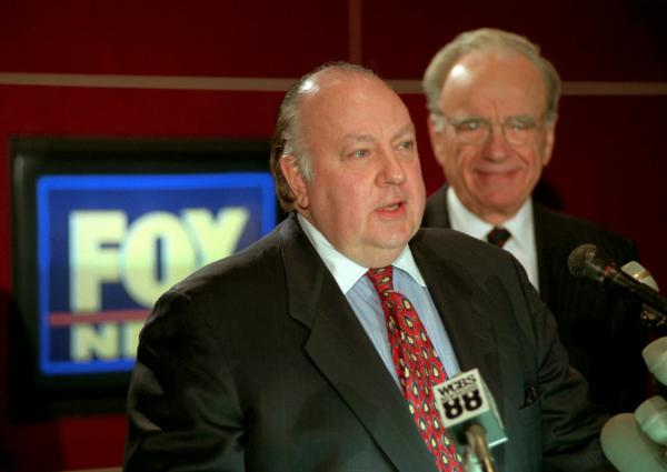 Roger Ailes (left) speaks at a news conference with Rupert Murdoch in January 1996 after it was announced Ailes would be chairman and CEO of Fox News.