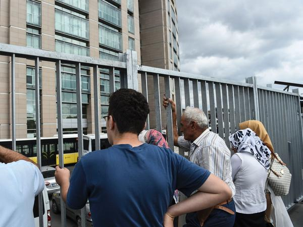 Family members of detained Turkish soldiers wait in front of the Istanbul Justice Palace on July 20.