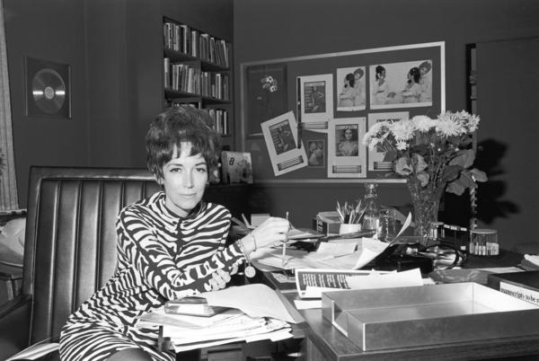 "Helen Gurley Brown in her office at <em>Cosmopolitan</em> magazine in the 1960s .The legendary editor, subject of two new biographies, knew sex sells – and food brings in ad money. She cannily combined them with features like ""After Bed, What? (a light snack for an encore)."""