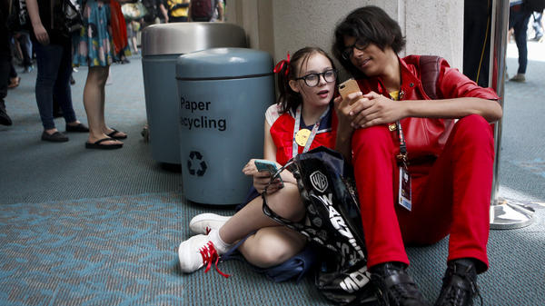 Malcolm Young and Chloe Dunbar are among the many people absorbed in Pokemon Go at this year's San Diego Comic-Con.