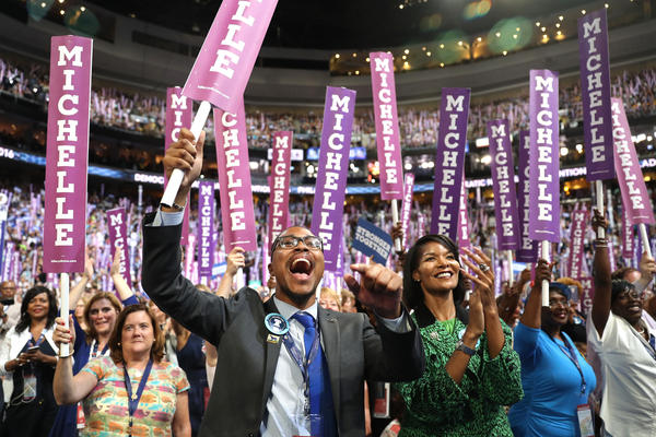 Delegates stand and cheer as first lady Michelle Obama speaks on the first day of the Democratic National Convention.
