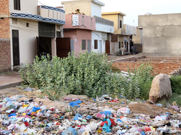 Trash is scattered in the alley leading to the house on the outskirts of Multan where Qandeel Baloch was murdered.