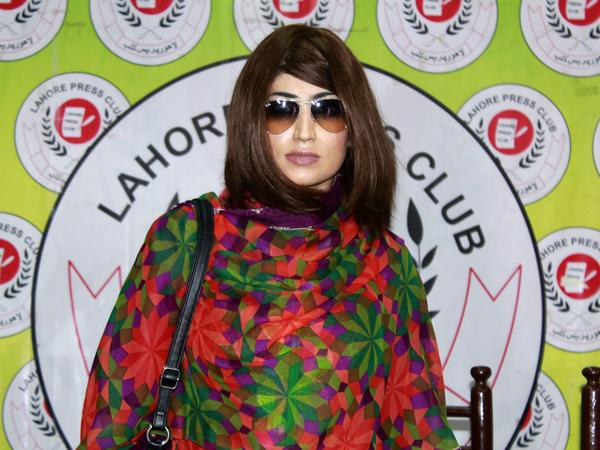 Qandeel Baloch, a Pakistani social media celebrity shown here at a June 28 press conference in Lahore, was murdered by her brother in an honor killing on July 15.