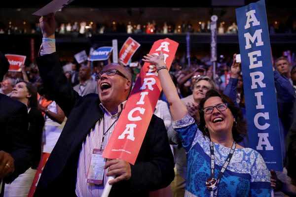 Delegates stand and cheer during the evening session on the second day of the Democratic National Convention.