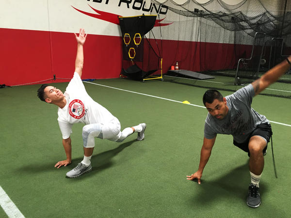 Shu stretches with trainer Eliseo Cabildo in Corona, Calif. Shu, 25, started playing badminton as an 8-years-old.