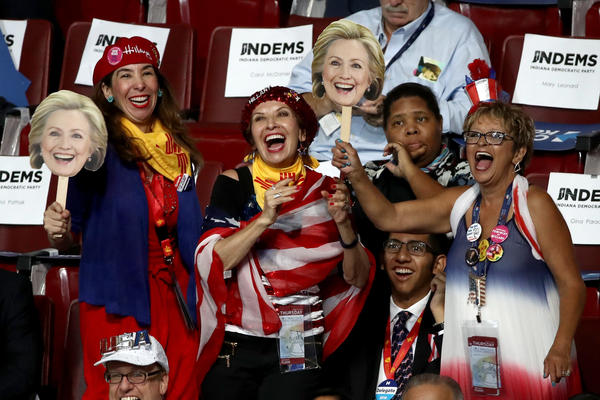 Delegates and attendees cheer during the fourth and final day of the Democratic National Convention.