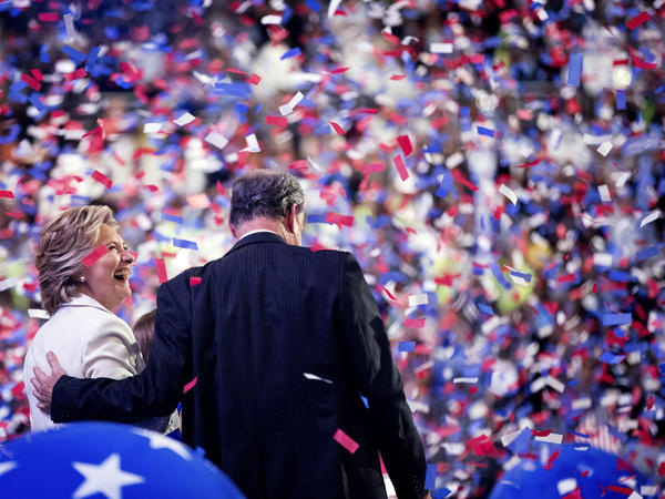 Hillary Clinton and Tim Kaine stand on stage amid celebratory balloons and confetti on the last day of the Democratic National Convention in Philadelphia on July 28.
