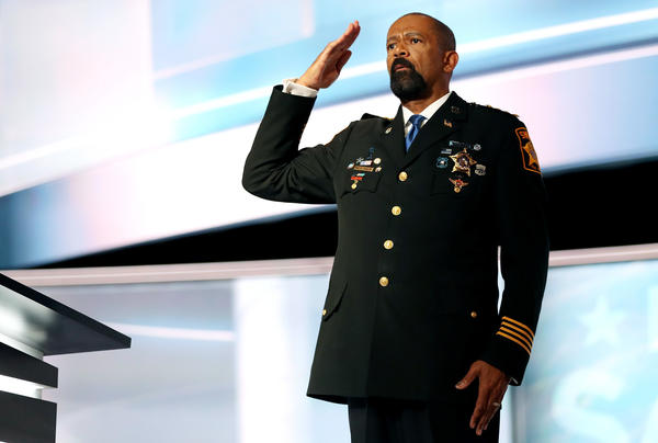 Milwaukee County Sheriff David Clarke salutes the crowd before delivering a speech on the first day of the Republican National Convention.