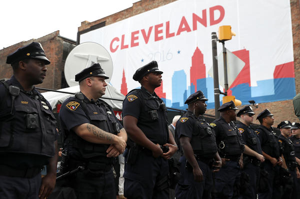 Cleveland police officers stand guard outside the site of the Republican National Convention.